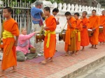 Monks gathering alms